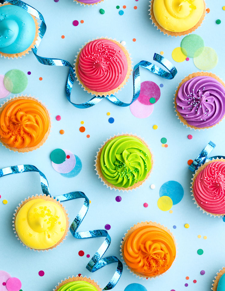 Colorful Cupcakes With Confetti On A Blue Background