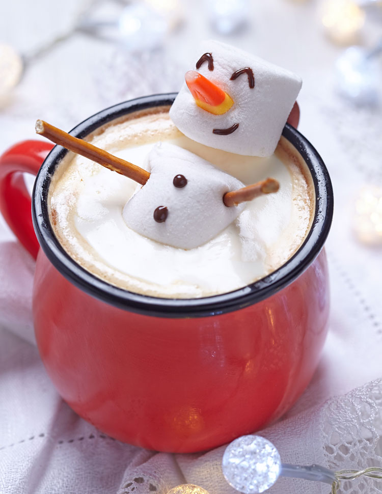 Marshmallow Snowman Melting In A Mug Of Hot Chocolate