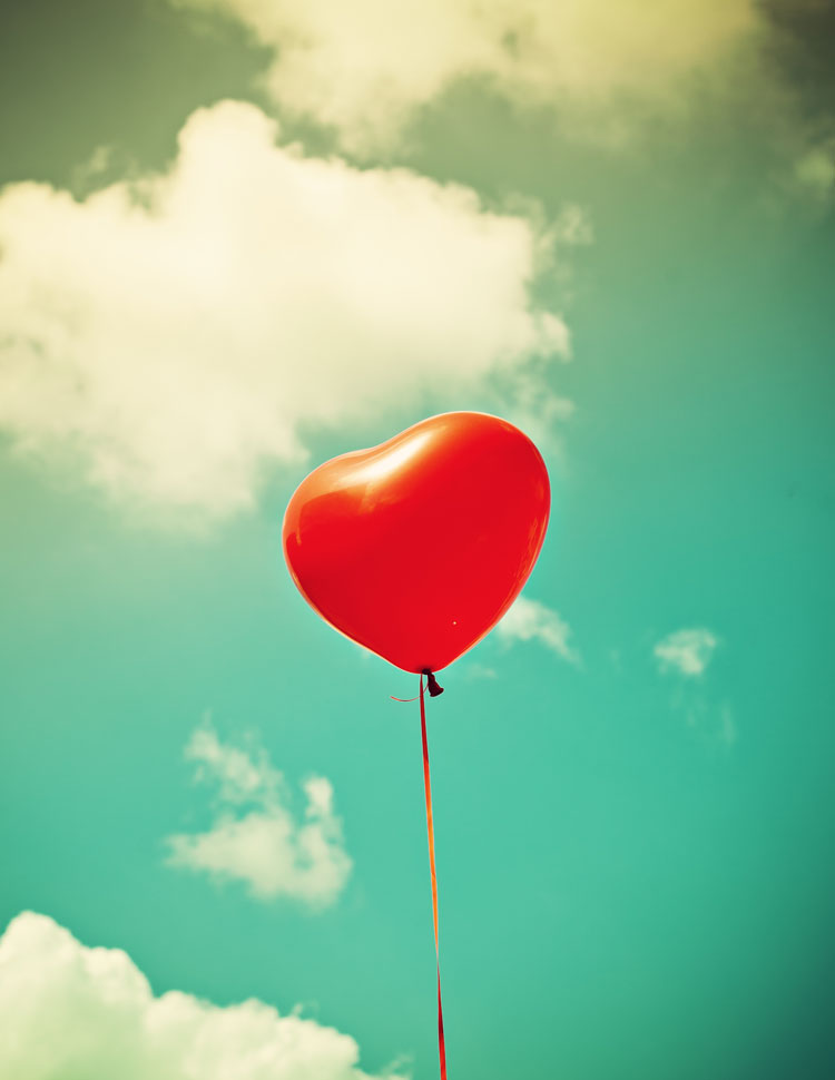 Red Heart Shaped Balloon With A Sky Background